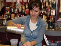 Samantha makes a whiskey sour at American Bartenders School