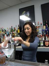 Felica Pours a Martini at Ameican Bartending School