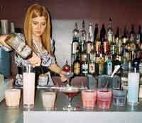 Natasha bartender school graduate makes a Long Island Ice T